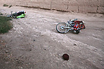 Two Honda motorbikes lie abandoned by three Taliban fighters who tried to run but were shot and killed during an ambush by Canadian soldiers with the Royal 22nd Regiment in the village of Zalakhan in Kandahar province, Afghanistan. Aug. 8, 2009. DREW BROWN/STARS AND STRIPES