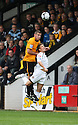 David Partridge of Cambridge United wins a header from Charlie Henry of Newport  during the Blue Square Bet Premier match between Cambridge United and Newport County at the Abbey Stadium, Cambridge  on 25th September, 2010.© Kevin Coleman