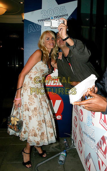 NANCY SORRELL.TV Quick & TV Choice Awards at the Dorchester Hotel, Park Lane, London..September 5th, 2005.full length fan taking picture photograph white floral print dress.www.capitalpictures.com.sales@capitalpictures.com.© Capital Pictures.