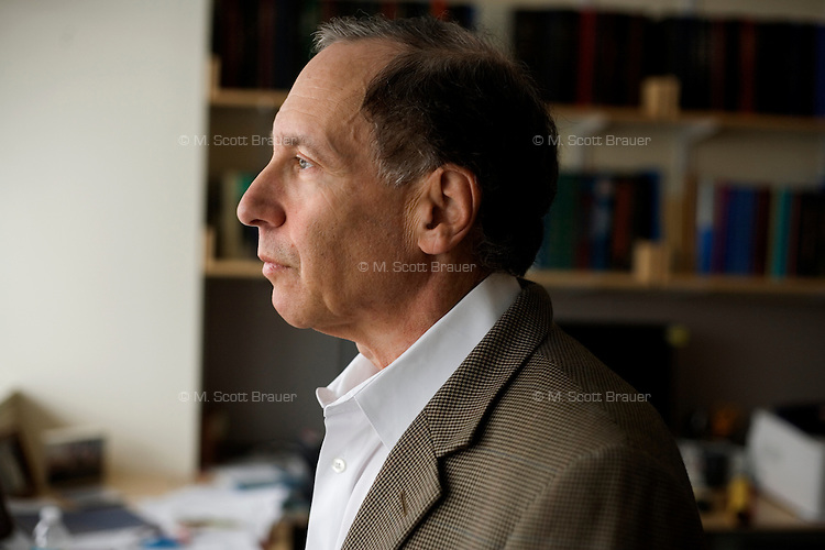 Photographed in his office, Professor Robert S. Langer poses for a portrait at the Koch Institute at MIT in Cambridge, Massachusetts, USA.  Working with Professor Michael J. Cima, Langer developed the device to allow repeated wireless drug delivery in lieu of injections.