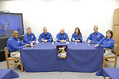 Kennedy Space Center, FL - August 8, 2007 -- The STS-118 crew enjoys a traditional meal on Wednesday, August 8, 2007 before suiting up for launch. Seated left to right are Mission Specialists Alvin Drew and Dave Williams, Pilot Charlie Hobaugh, Commander Scott Kelly, and Mission Specialists Tracy Caldwell, Rick Mastracchio and Barbara R. Morgan, the teacher-turned-astronaut. Space Shuttle Endeavour's STS-118 mission is the 22nd shuttle flight to the International Space Station. It will continue space station construction by delivering a third starboard truss segment, S5, and other payloads such as the SPACEHAB module and the external stowage platform 3. The 11-day mission may be extended to as many as 14 depending on the test of the Station-to-Shuttle Power Transfer System that will allow the docked shuttle to draw electrical power from the station and extend its visits to the orbiting lab. .Credit: Kim Shiflett - NASA via CNP