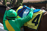 ARCADIA, CA  MARCH 11: Jockey Mike Smith gets a leg up on #4 Mastery, before the San Felipe Stakes  (Grade ll) on March 11, 2017, at Santa Anita Park in Arcadia, CA. (Photo by Casey Phillips/Eclipse Sportswire/Getty Images)
