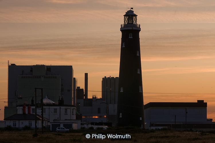 Disused lighthouse and Dungeness Nuclear Power Station, Kent. Dungeness B is an Advanced Gas Cooled Reactor; the older Dungeness A Magnox reactor was decommissioned in 2006.