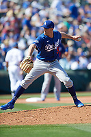 Los Angeles Dodgers pitcher Adam Kolarek (56) delivers a pitch during a Cactus League Spring Training game against the Texas Rangers on March 8, 2020 at Surprise Stadium in Surprise, Arizona. Rangers defeated the Dodgers 9-8. (Tracy Proffitt/Four Seam Images)