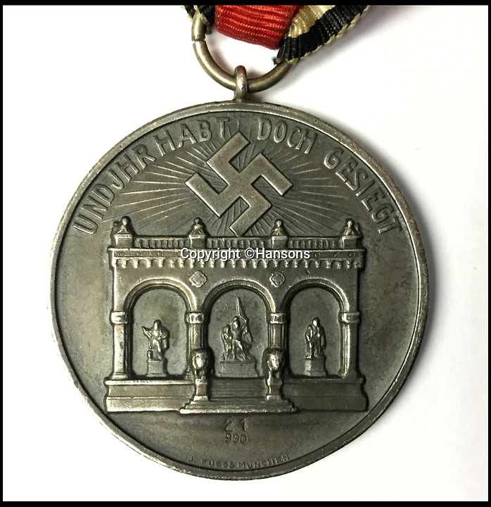 BNPS.co.uk (01202 558833)<br /> Pic:   Hansons/BNPS<br /> <br /> A rare medal awarded to the man who 'changed the course of history' by saving Adolf Hitler's life is coming up for sale.<br /> <br /> Ulrich Graf was the bodyguard for the Nazi dictator at the time of the famous Beer Hall Putsch in Munich in November 1923.<br /> <br /> The revolutionary coup by the rising Nazi party to seize power in Bavaria resulted in a bloody battle with police, with 16 party members and four officers killed.<br /> <br /> Ulrich, a burly former wrestler, threw himself on Hitler and was shot five times but survived.<br /> <br /> Had he not done his job, Hitler could have been killed, the Nazis may never have come to power and the Second World War could have been avoided.
