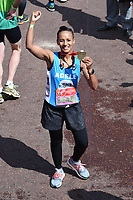 Adelle Roberts<br /> carried away by St John's Ambulance at the finish line on The Mall at the 2017 London Marathon, London. <br /> <br /> <br /> ©Ash Knotek  D3254  23/04/2017