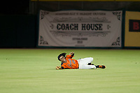 AZL Giants center fielder Ismael Munguia (29) attempts a diving catch against the AZL Rangers on August 22 at Scottsdale Stadium in Scottsdale, Arizona. AZL Rangers defeated the AZL Giants 7-5. (Zachary Lucy/Four Seam Images via AP Images)