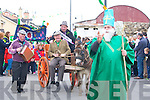 PARADE: St Patrick (Gerry Carmody) with Sony Egan, John Brennan (marshall) and Bosco McMahon who led the St Patrick's Day parade in Kilflynn on Monday.