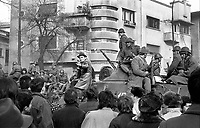 ROMANIA, Bucharest, 22.12.1989<br /> People rise against Ceausescu. Protestors besiege the national television headquarters and try to get in. News arrive that the Ceausescu couple has fled. The soldiers around the TV station are confused.<br /> © Andrei Pandele / EST&OST