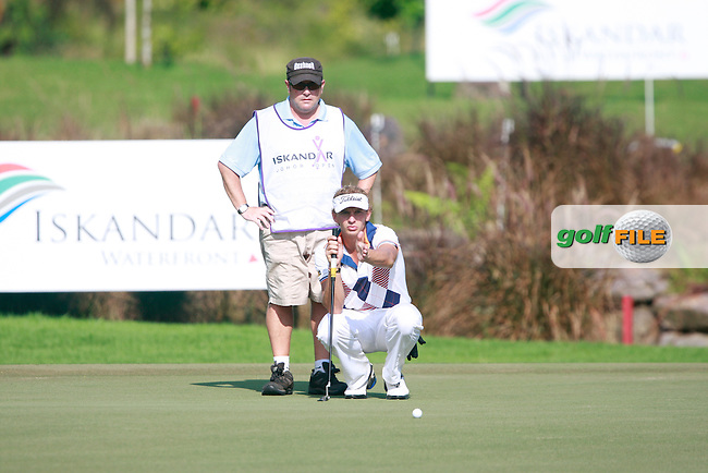 Joost Luiten (NED) lines up his putt with caddy Martin Gray on the 14th green during Saturday's storm delayed conclusion of Round 2 of the Iskandar Johor Open 2011 at the Horizon Hills Golf Resort Johor, Malaysia, 19th November 2011 (Photo Eoin Clarke/www.golffile.ie)
