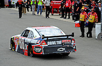 May 1, 2009; Richmond, VA, USA; NASCAR Sprint Cup Series driver Dale Earnhardt Jr heads into the garage for repairs after crashing during practice for the Russ Friedman 400 at the Richmond International Raceway. Mandatory Credit: Mark J. Rebilas-