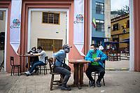 """BOGOTA - COLOMBIA, 05-09-2020: Comensales esperan durante el primer día del piloto de apertura de restaurantes y cafés al aire libre, denominado """"Bogotá a Cielo Abierto"""", en el Chorro de Quevedo en el centro de Bogotá que ahora tiene sus calles pintadas con formas geométricas en pintura neón y cuenta con mesas, distribuidas estratégicamente para mantener el distanciamiento físico al finalizar la cuarentena total en el territorio colombiano causada por la pandemia  del Coronavirus, COVID-19. / Dinners await during the first day of the pilot for the opening of restaurants and outdoor cafes, called """"Bogotá a Cielo Abierto"""", in Chorro de Quevedo in the center of Bogotá, which now has its streets painted with geometric shapes in neon paint and has tables, strategically distributed to maintain physical distancing at the end of the total quarantine in the Colombian territory caused by the Coronavirus pandemic, COVID-19. Photo: VizzorImage / Johan Rugeles / Cont"""