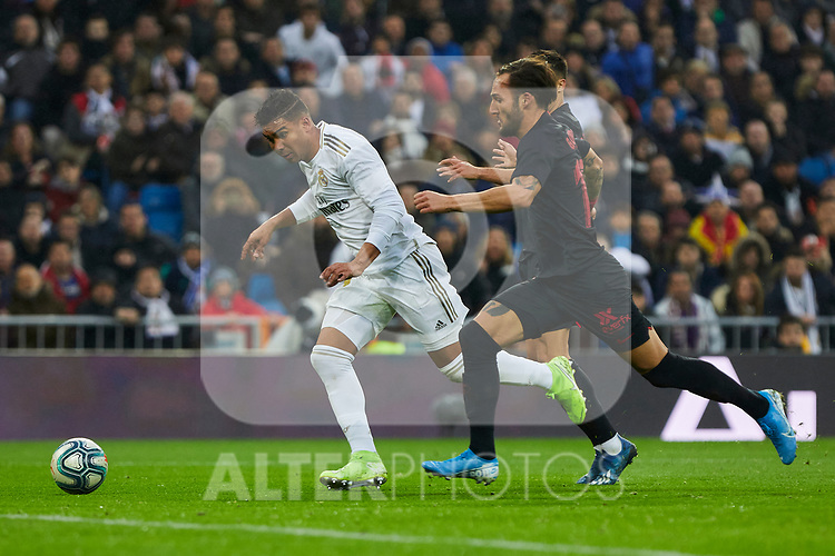 Carlos Henrique Casemiro of Real Madrid and Gudelj of Sevilla FC during La Liga match between Real Madrid and Sevilla FC at Santiago Bernabeu Stadium in Madrid, Spain. January 18, 2020. (ALTERPHOTOS/A. Perez Meca)