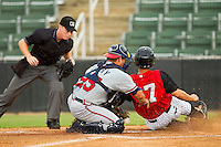 Rome Braves catcher Ryan Query (25) drops the ball as he tries to tag Joey DeMichele (17) of the Kannapolis Intimidators at home plate against the Kannapolis Intimidators at CMC-Northeast Stadium on August 5, 2012 in Kannapolis, North Carolina.  The Intimidators defeated the Braves 9-1.  (Brian Westerholt/Four Seam Images)
