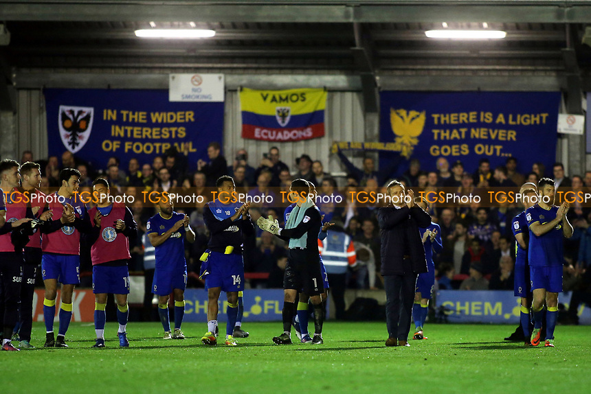 AFC Wimbledon walk around the pitch at the end of the match to applaud their fans and celebrate their historic victory during AFC Wimbledon vs MK Dons, Sky Bet EFL League 1 Football at the Cherry Red Records Stadium on 14th March 2017