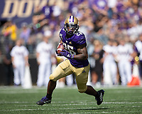 Salvon Ahmed started at running back for the Huskies and finished with 44 yards rushing and a touchdown.
