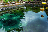 Bali, Gianyar, Tirtha Empul. Pura Tirtha Empul temple close to Tampaksiring. This is the holy springs where you can see the very clear water pouring from the ground (dark circles in the lower left part of the photo.