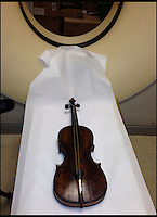 BNPS.co.uk (01202 558833)<br /> Picture: HAldridge/BNPS<br /> <br /> ****Please use full byline****<br /> <br /> The violin which had to go through a hospital CT Scanner to prove it's authenticity. <br /> <br /> The violin played by the bandmaster on the Titanic as the ship was sinking is finally being auctioned for an estimated &pound;400,000.<br /> <br /> The wooden instrument has been proven to be the one used by Wallace Hartley as his band famously played on to help keep the passengers calm during the disaster.<br /> <br /> Its existence and survival only emerged in 2006 when the son of an amateur violinist who was gifted it by her music teacher in the early 1940s contacted an auctioneers.