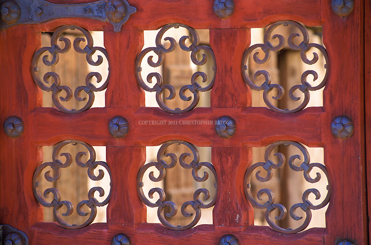 "Gate details at Scotty's Castle, two-story Mission Revival and Spanish Colonial Revival style Villa in the Grapevine Mountains of northern Death Valley. Also known as Death Valley Ranch. Construction began in 1922, and cost between $1.5 and $2.5 million. Walter Scott born in Cynthiana, Kentucky, also known as ""Death Valley Scotty"", convinced Chicago millionaire Albert Johnson to invest in his gold mine in the Death Valley area. Johnson built ranch for winter retreats with his wife. Scott is buried on hill above ranch alongside his beloved dog. Death Valley National Monument Est. February 11, 1933. Est. as Death Valley National Park in 1994; 5,270 square miles (13,649 km2). Inyo County, CA."