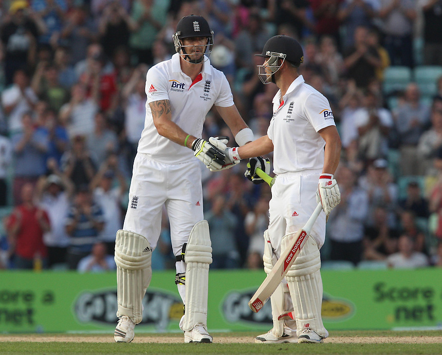 England's Kevin Pietersen celebrates his half century with team-mate Jonathan Trott <br /> <br /> Photo by Kieran Galvin / CameraSport<br /> <br /> International Cricket - Fifth Investec Ashes Test Match - England v Australia - Day 5 - Thursday 25th August 2013 - The Kia Oval - London<br /> <br /> &copy; CameraSport - 43 Linden Ave. Countesthorpe. Leicester. England. LE8 5PG - Tel: +44 (0) 116 277 4147 - admin@camerasport.com - www.camerasport.com