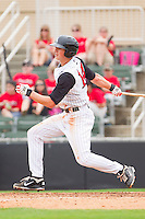 Ryan Hamme #14 of the Kannapolis Intimidators follows through on his swing against the West Virginia Power at Fieldcrest Cannon Stadium on April 20, 2011 in Kannapolis, North Carolina.   Photo by Brian Westerholt / Four Seam Images