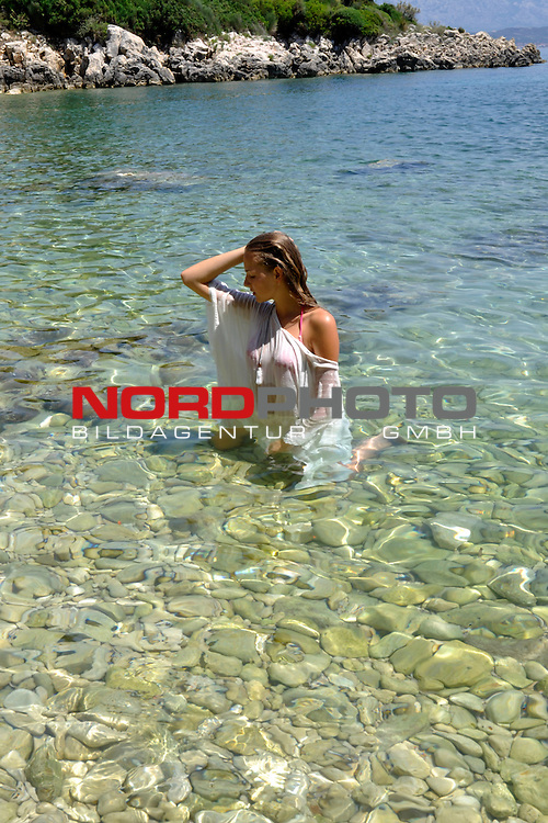 10.06.2015., Rab island, Croatia - Visitors enjoying sun on the beach.<br />  Foto &copy; nph / Photo: Goran Novotny