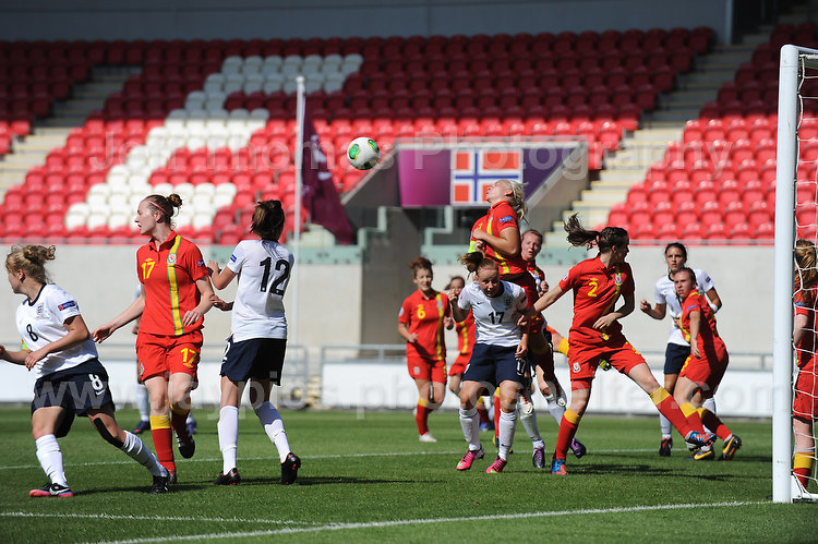 A scramble for the ball during the UEFA Womens U19 Championships at Parc y Scarlets, Monday 19th August 2013. All images are the copyright of Jeff Thomas Photography-www.jaypics.photoshelter.com-07837 386244-Any use of images must be authorised by the copyright owner.