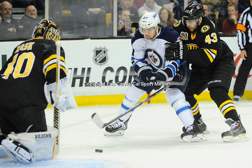 January 2, 2014 - Boston, Massachusetts, U.S. - Winnipeg Jets right wing Michael Frolik (67) and Boston Bruins defenseman Matt Bartkowski (43) battle for the puck in front of goalie Tuukka Rask (40) during the NHL game between Winnipeg Jets and the Boston Bruins held at TD Garden in Boston Massachusetts.  Boston defeated Winnipeg 4-1 in regulation. Eric Canha/CSM