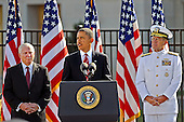 """United States President Barack Obama, speaking at the Pentagon on Saturday, September 11, 2010, recalled """"that awful morning"""" nine years ago when a group of 5 terrorists from Osama bin Laden's al Qaeda organization hijacked an airliner bound for Los Angeles, California, and crashed it into the side of the building behind him.  He went on to say that despite the terrorists' efforts to foster conflicts among the world's faiths, """"As Americans we are not -- and never will be -- at war with Islam.""""  Obama was joined on the podium by U.S. Secretary of Defense Robert M. Gates and Chairman of the Joint Chiefs of Staff Admiral Mike Mullen.  .Mandatory Credit: Robert D. Ward - DoD via CNP"""