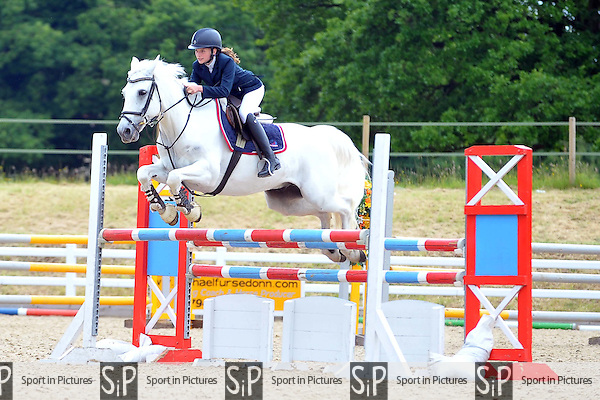 Class 4. Squibb Group Pony Foxhunter. British Showjumping Junior show. Brook Farm Training Centre. Essex. 14/06/2015. MANDATORY Credit Ellie Ingram/Sportinpictures - NO UNAUTHORISED USE - 07837 394578