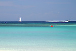 The waters off West Bay in Roatan Honduras are busy with boating and sailing acitivity.