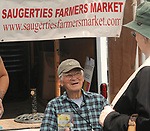 Market Committee member, Barry Benape, at the managers booth at the Saugerties Farmer's Market on Main Street in the Village of Saugerties, NY, on Saturday, June 10, 2017. Photo by Jim Peppler. Copyright/Jim Peppler-2017.