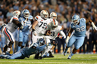 CHAPEL HILL, NC - NOVEMBER 02: D.J. Ford #16 of the University of North Carolina sacks Bryce Perkins #3 of the University of Virginia during a game between University of Virginia and University of North Carolina at Kenan Memorial Stadium on November 02, 2019 in Chapel Hill, North Carolina.