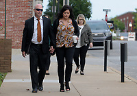 NWA Arkansas Democrat-Gazette/DAVID GOTTSCHALK Former state representative Micah Neal (left) walks Thursday, September 13, 2018, with his wife Cindy to the John Paul Hammerschmidt Federal Building in Fayetteville. Neal was to be sentenced for conspiracy to commit fraud in kickback scheme involving state General Improvement Fund grants.