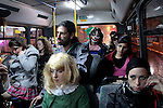 On a regular bus during the celebrations of Purim in Jerusalem, Line No. 19 on the way to Betzalel Arts Academy party. Photo (C) Quique Kierszenbaum