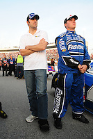May 2, 2008; Richmond, VA, USA; NASCAR Nationwide Series driver Dario Franchitti (left) stands on pit road with a cast on his left foot after an injury the week prior during the Lipton Tea 250 at the Richmond International Raceway. Mandatory Credit: Mark J. Rebilas-US PRESSWIRE
