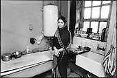 Bath in the kitchen of a <br /> Bangladeshi woman in living with her husband and five children in a two-bedroom council flat in Levita House, King's Cross.
