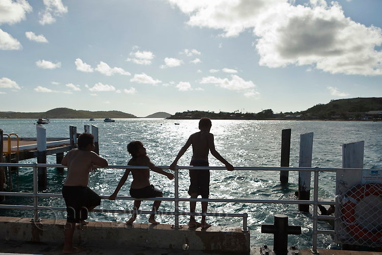 Boys swimming off the jetty at Thursday Island, Torres Strait Islands, Queensland, Australia