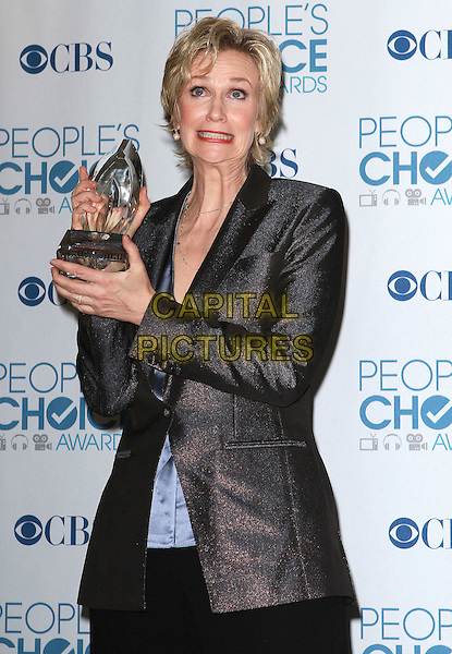 JANE LYNCH .2011 People's Choice Awards held at Nokia Theatre L.A. Live, Los Angeles, California, USA..January 5th, 2011.half length black suit award trophy winner grey gray jacket sparkly smiling funny.CAP/ADM/KB.©Kevan Brooks/AdMedia/Capital Pictures.