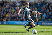 Luke O'Nien of Wycombe Wanderers reaches for the ball during the Sky Bet League 2 match between Wycombe Wanderers and Plymouth Argyle at Adams Park, High Wycombe, England on 12 September 2015. Photo by Andy Rowland.