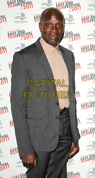 "GARY POWELL .at ""The Libertines - There Are No Innocent Bystanders"" East End Film Festival opening gala premiere, The Troxy, Shadwell, London, England, UK, .April 27th 2011..half length grey gray pinstripe suit beige shirt  .CAP/CAN.©Can Nguyen/Capital Pictures."
