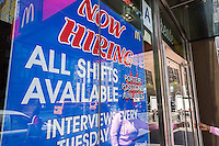 A sign in the window of a McDonald's restaurant in New York on Tuesday, April 19, 2016 announces that it is hiring. (© Richard B. Levine)