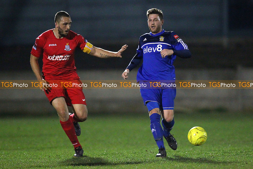 Petrit Elbi of Aveley and Aaron Scott of Redbridge - Aveley vs Redbridge - Ryman League Division One North Football at Mill Field, Aveley, Essex - 23/03/15 - MANDATORY CREDIT: TGSPHOTO - Self billing applies where appropriate - contact@tgsphoto.co.uk - NO UNPAID USE
