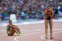 05 AUG 2012 - LONDON, GBR - Hayat Lambarki (MAR) (right) of Morocco  watches the video replay of her women's 400m hurdles round 1 heat during the London 2012 Olympic Games athletics in the Olympic Stadium at the Olympic Park in Stratford, London, Great Britain (PHOTO (C) 2012 NIGEL FARROW)