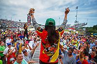 May 15, 2016; Commerce, GA, USA; NHRA pro stock motorcycle rider Angelle Sampey waves to the fans at driver introductions during the Southern Nationals at Atlanta Dragway. Mandatory Credit: Mark J. Rebilas-USA TODAY Sports