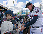 Aces Kevin Cron signs a baseball for a fan before the 2019 opening day game between the Reno Aces and the Albuquerque Isotopes at Greater Nevada Field in Reno, Nevada on Tuesday, April 9, 2019.
