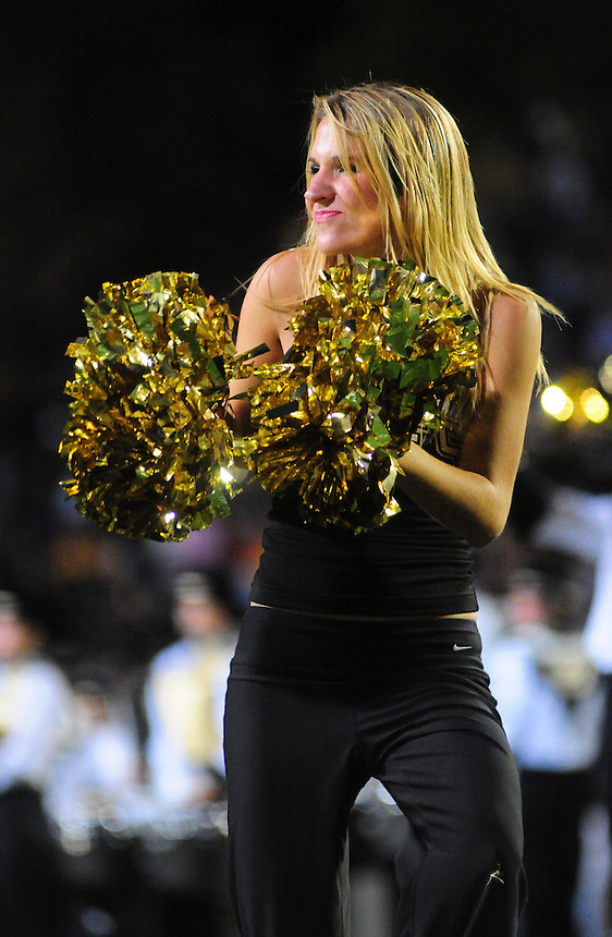 18 October 08: A Colorado cheerleader performs during half time of a game against Kansas State. The Colorado Buffaloes defeated the Kansas State Wildcats 14-13 at Folsom Field in Boulder, Colorado.