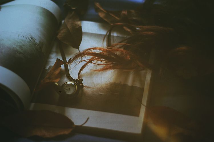 photograph of a book, a clock and a girl's long hair with retro feeling