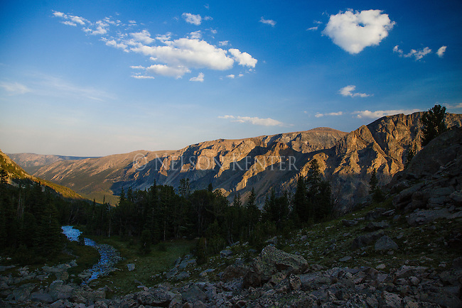 a stream and mountains at sunset between september morn lake and keyser brown lake in the absaroka beartooth wilderness in montana