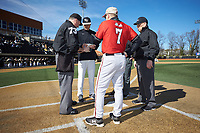 Wake Forest Demon Deacons head coach Tom Walter (16) exchanges lineups with Gardner-Webb Runnin' Bulldogs head coach Rusty Stroupe (7) and home plate umpire Jamie Roebuck (left) as first base umpire Tony Carilli looks on at David F. Couch Ballpark on February 18, 2018 in  Winston-Salem, North Carolina. The Demon Deacons defeated the Runnin' Bulldogs 8-4 in game one of a double-header.  (Brian Westerholt/Four Seam Images)